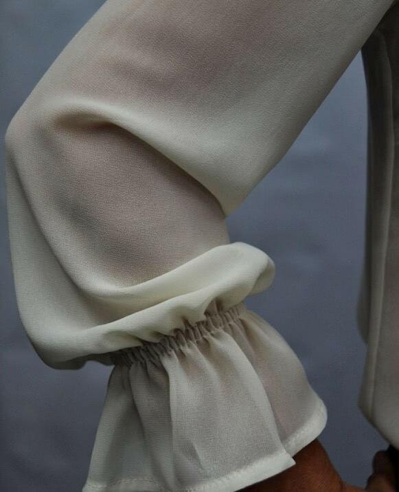 Blusa manga larga lazo negro