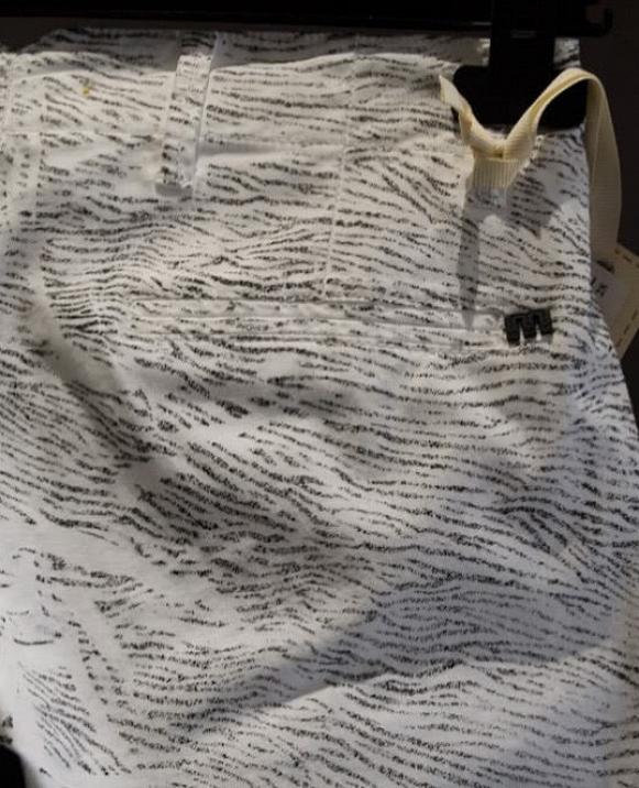 Pantalón blanco estampado cebra