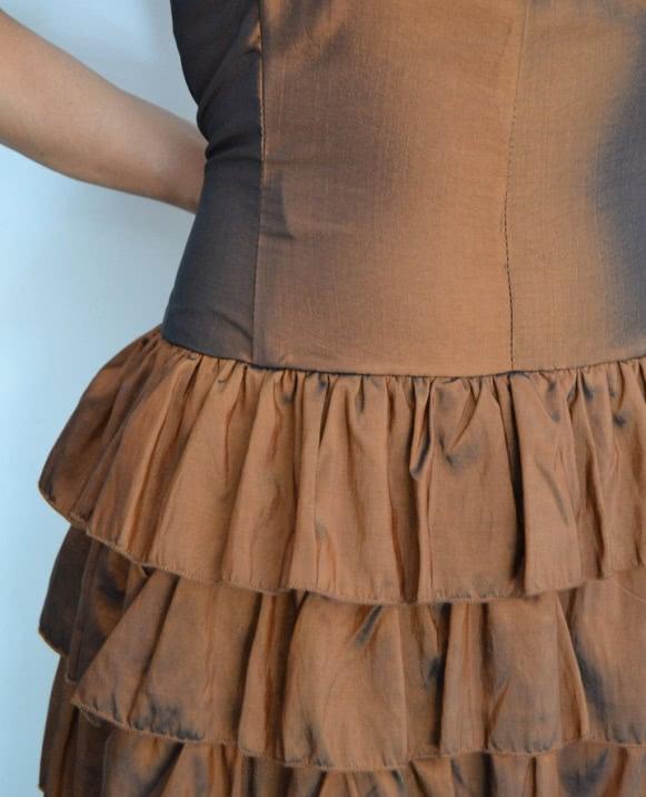 Vestido brillo lazo cintura